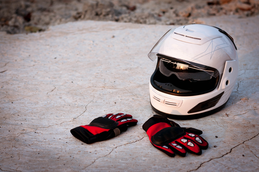 Motorbike helmet and gloves.